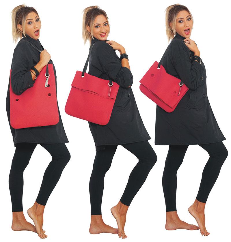 Borsa Cini N°2 in silicone rosso con tracolla in pelle indossata da modello