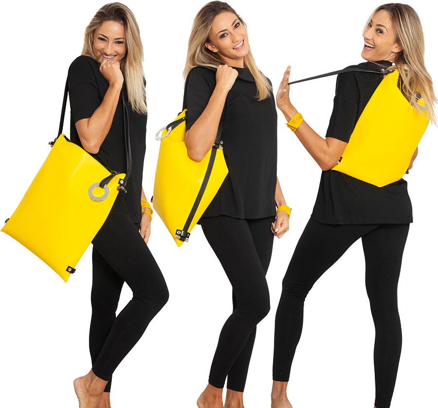 Borsa a tracolla trasformabile in zaino LILLY in pelle RICICLATA colore giallo smile DAMPAÌ, indossata da modello