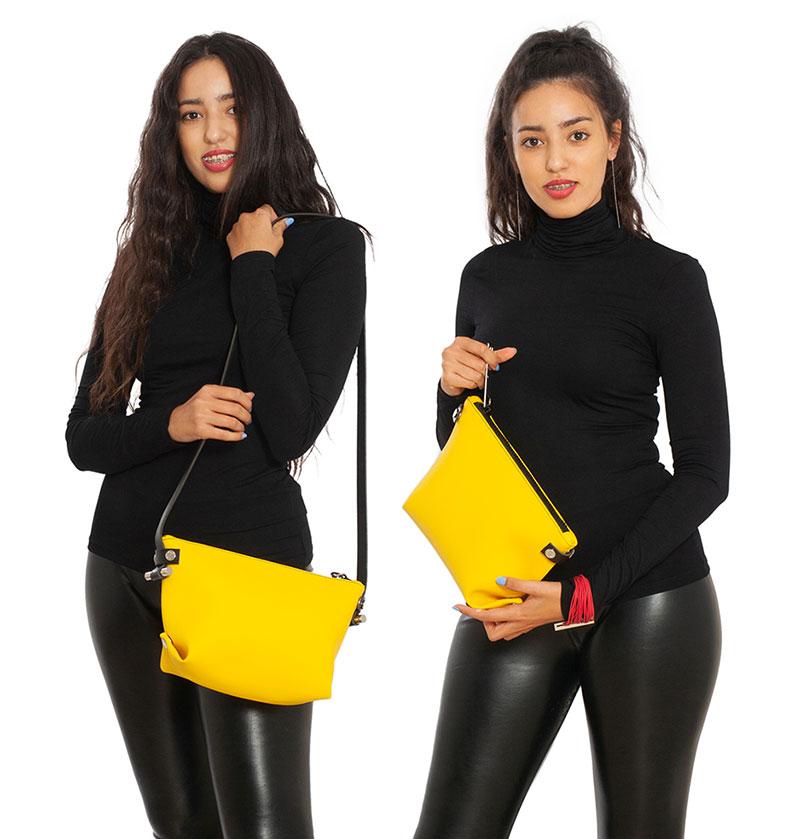 Pochette trasformabile La POUCH & TRACOLLA in pelle riciclata colore giallo smile DAMPAÌ , con tracolla rimovibile, indossata da modello.